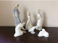 A collection of Lladro and Nao figurines. 6 pieces, selling as a set. Excellent condition.
