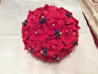 Red bridal flower bouquet with matching bridesmaid rose pearl corsage