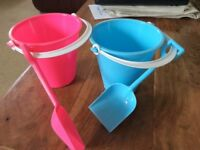 Kids plastic buckets and spades
