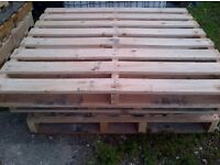 strong wooden pallets ideal for fencing, decking, furniture