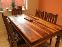 Solid Calabash wood table and chairs with cushions