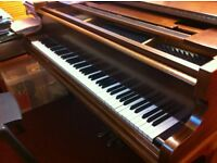 Baby grand piano for sale. Challen. Good condition.