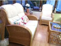 Conservatory furniture In cream upholstery which has been scotchguard protected.