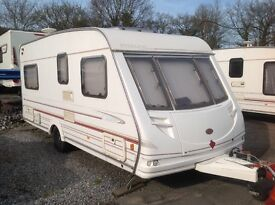 Sterling Eccles Onyx 4 berth touring caravan fixed end bed and awning.