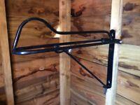 Folding horse saddle bracket