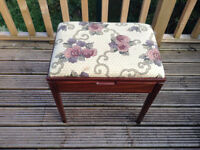 Vintage piano stool in dark wood with hinged padded seat with storage