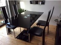 Black glass dining table and 4 chairs £80ono