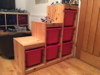 Toy storage - ikea unit with six red trays