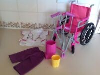 18 inch Dolls toy wheelchair and accessories includes outfit.