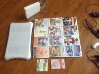 Nintendo wii with wii fit board, 12 games and various controls