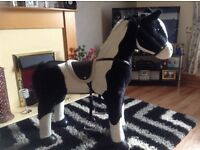 Children's play horse , press ear for horse noises