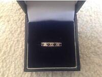 Sapphire &a diamond eternity ring