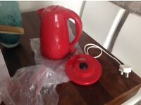 Red electric kettle and base £5
