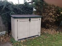 Garden storage unit, doors open out & lid lifts up.