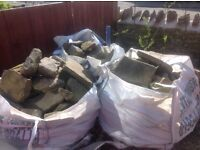 3 dumpy bags of grey pennant stone from old garden wall