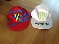 Two monster energy caps