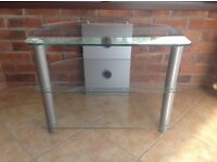 Three shelved clear glass TV stand with silver legs