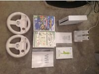 Wii bundle including wii fit board, 2 consoles, 2 steering wheels, 15 games