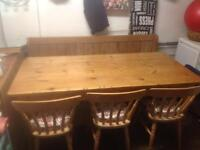Solid pine six foot table together with original six foot church pew and three solid cottage chairs.