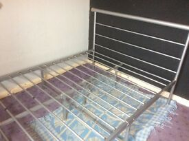 Metal double bed frame, 6 months usage,ready for collection, can be dismantled for ease.