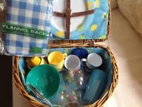 Vintage style picnic basket and contents