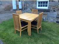 John Lewis oak dining room table and four chairs.