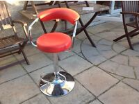 Red pleather hydronic stool