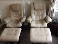 2 Leather recliner chairs with foot rests
