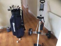 Golf clubs, bag and caddy