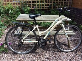 "Ladies bicycle. Reebok Ellipse Women's 16"" with pannier rack."