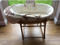 Moses basket with rocking stand, originally from Mothercare.