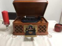 Record player/cd player/radio.