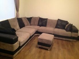 Black and grey corner sofa with storage footstool
