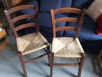 2 wooden chairs woven seats