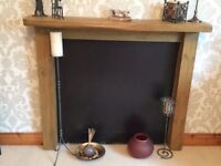 Rustic wooden fire surround. Approx 48 x48""