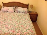 Bedroom furniture. Includes king size bed, side table and chest of drawers