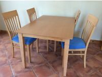 Dining table and 4 cushioned chairs