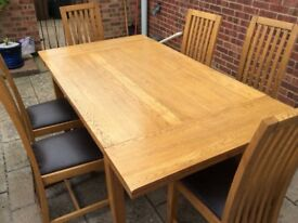 Solid oak dinner table and chairs