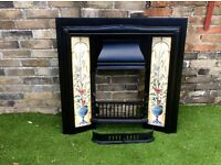 Recently refurbished Victorian style cast iron fireplace with decorative tiles