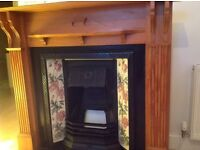 FIREPLACE COMPLETE WITH PINE SURROUND. £295