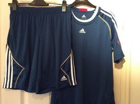 Adidas mans running/gym shorts and top size medium. Good condition.