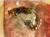 Pandora style charm bracelet with 5 charms of choice!