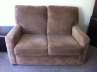 Two Draylon light brown two seater settees