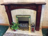 Dark Wood Fire Surround with heavy Marble Back and Plinth.