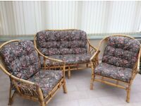 Bamboo cane 2 Seater Sofa, 2 Chairs and a Glass top Coffee Table