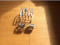 Toast rack and two napkin rings