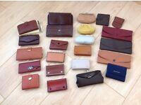Job lot of 22 purses and wallets.