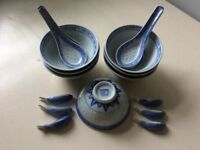 Chinese bowls, spoons and chopstick rests