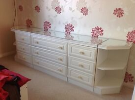 A lovely range of 5 white bedroom units.