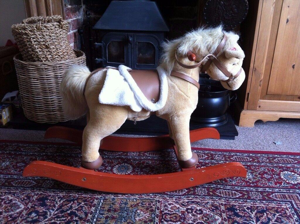 Cuddly moving sound making rocking horse
